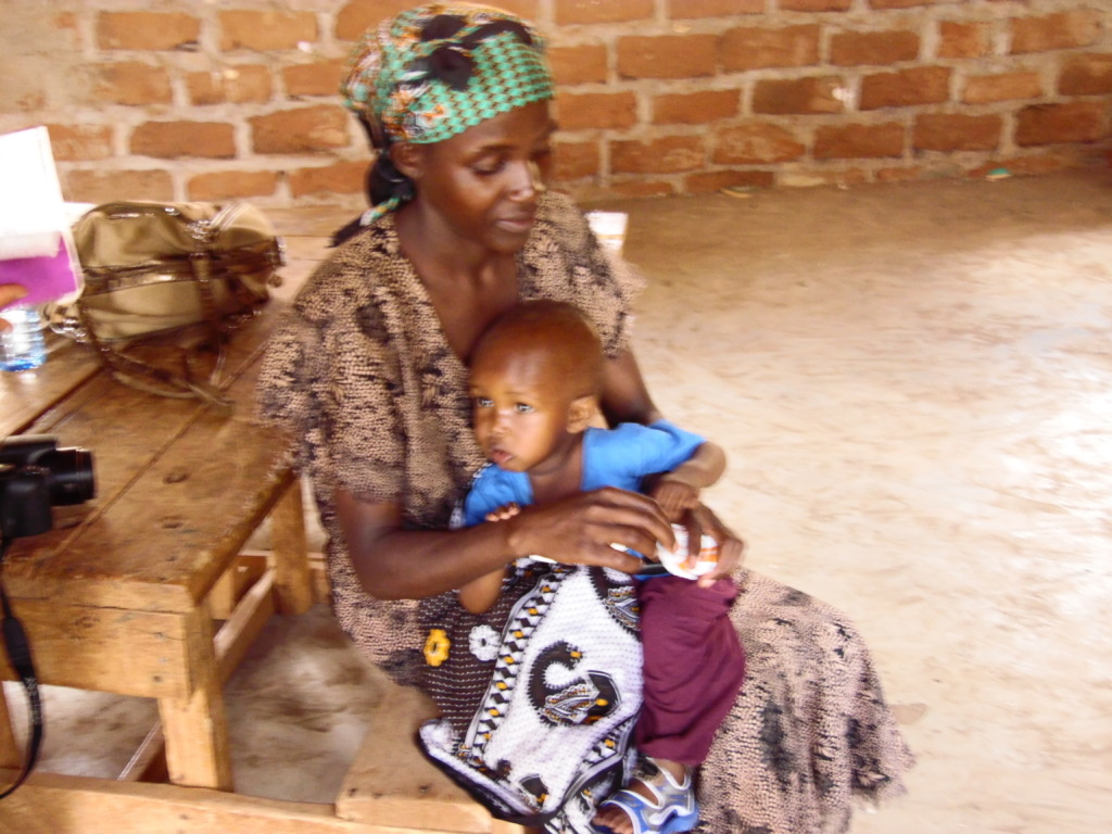 Angela feeding her child at the outreach clinic