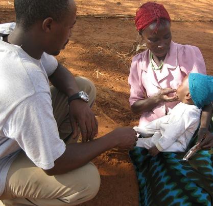 Child Receiving PlumbyNut from Nurse Nicholas