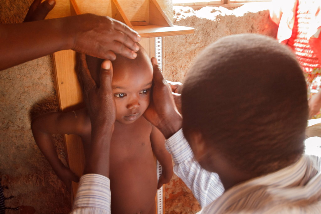A CHW monitoring a child