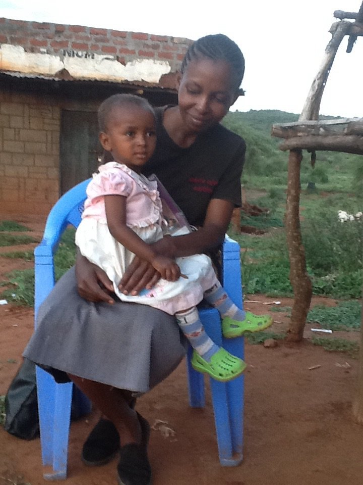 Mary with her mother in Ndiuni village