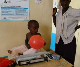 Weighing a child in Kisesini Clinic