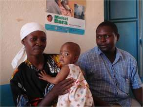 Nurse Nicholas Mutuku with a mother and child