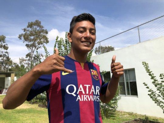 Eliud wearing his Barcelona shirt