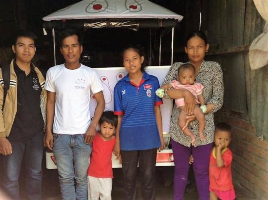 Rotha and her family with the new Tuk Tuk