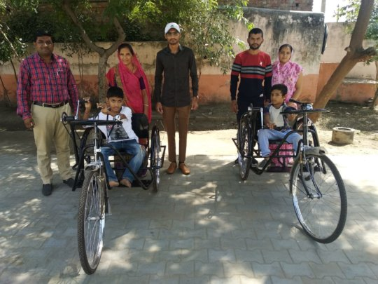 Tricycles were given to students