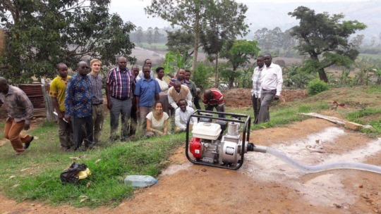 Voluteers and Rwampara staff with the sprinkler