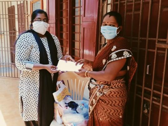 Distributing cash, food, and health supplies