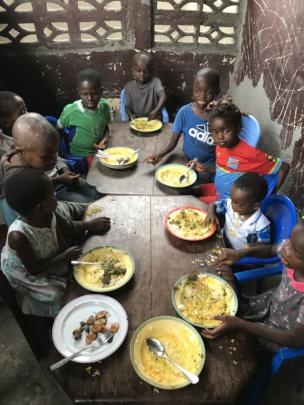 Children eating palm weevil larvae 3