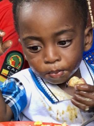 Children eating palm weevil larvae 2