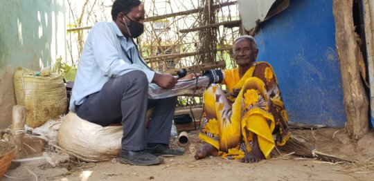 Healthcare worker monitors blood pressure