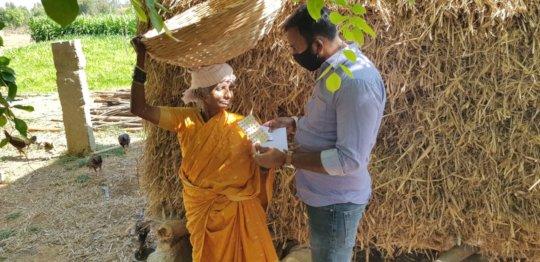 An elderly patient gets her medicines