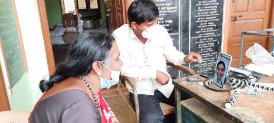 A patient receives e-consultation