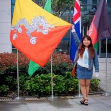 AUW Student Tshering with the Bhutan Flag