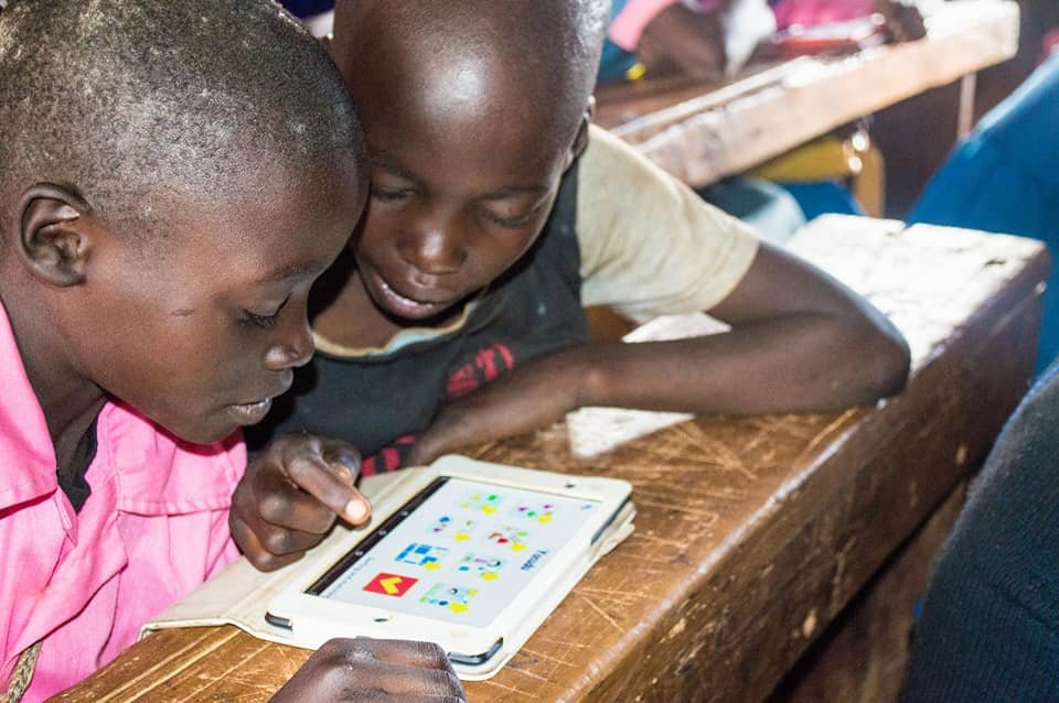 Students in Kenya working with OneBillion Apps
