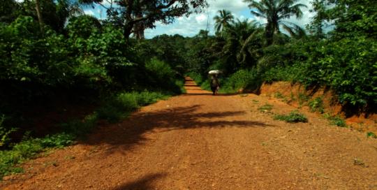 Farmer walking home on a  sandy road to Rochin