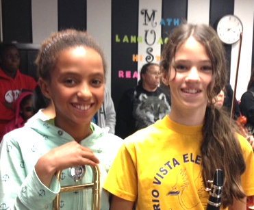 Mae C with her trombone (pictured left)