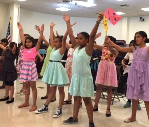 Students perform at a Compton School Board mtg