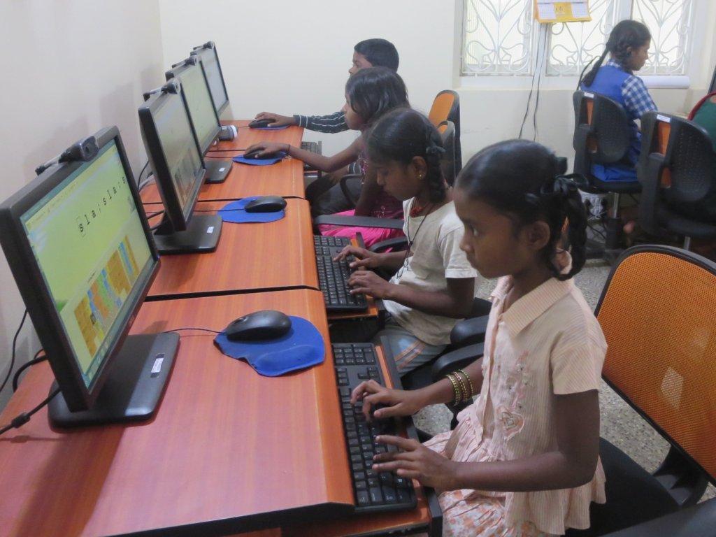 Support and educate 400 slum children in Bangalore