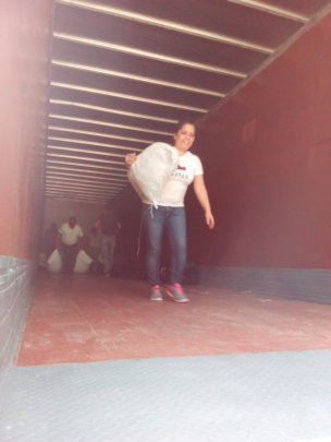 Gisela carrying sacks of Chispuditos