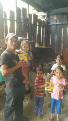 Jose Genaro with four children in his home