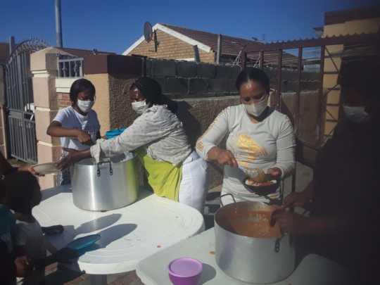 One of our partner organisations feeding neighbors