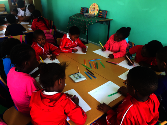 Children learning in Blessings new classroom