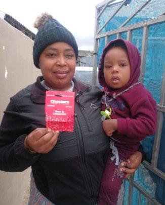 A family receiving a food voucher