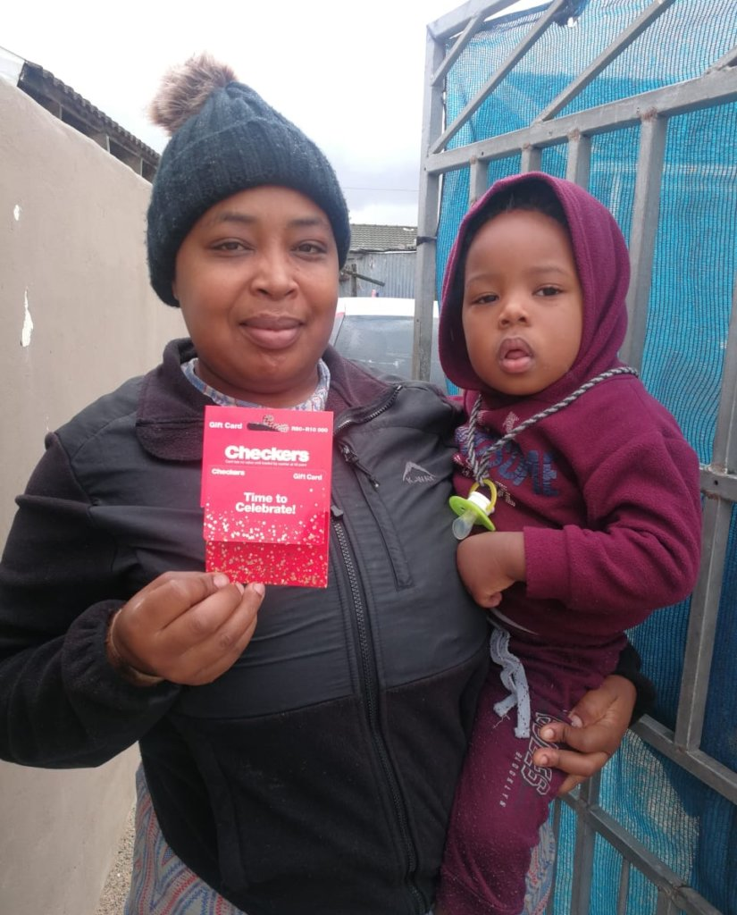 A family receiving a food voucher