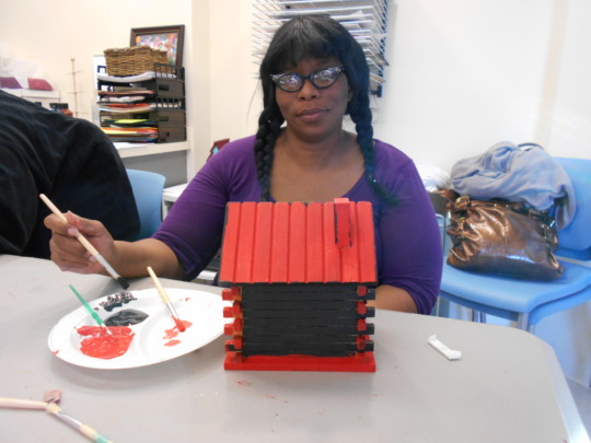 A woman healing while creating art.
