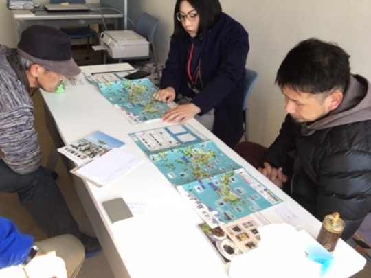 Staff looking over map of the islands