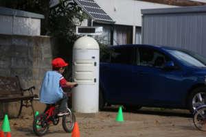 Child plays near radiation monitoring post