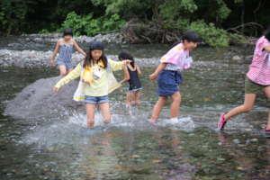 Enjoying splashing in shallow river