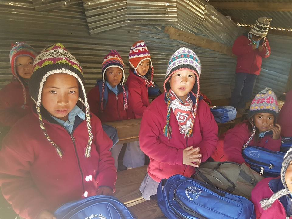 with their jacket,hat and bag in classroom