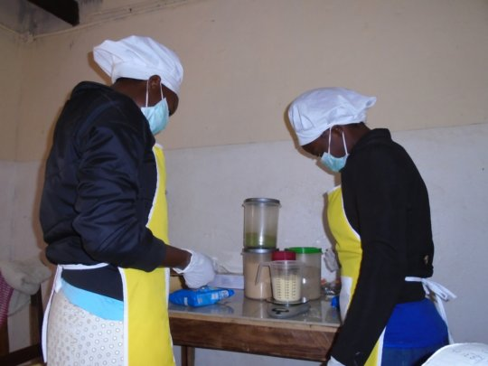 weighing of dry milk for the ONENEPA in clean room