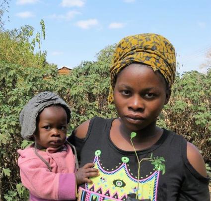 Gracious, her mother and moringa plant
