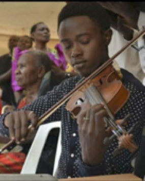 Davis playing at a function in the village