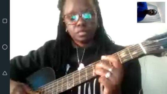 Amelia having a guitar lesson
