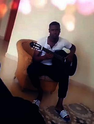 John Paul Practicing in his home