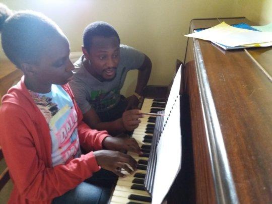 Kristen having a piano lesson
