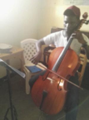 John Paul playing the cello