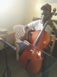 John Paul playing the cello