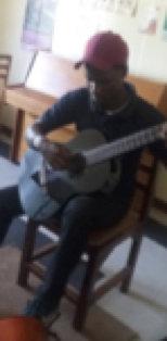 John Paul practising the guitar