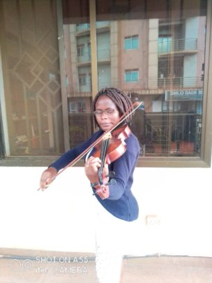 Phiona practicing her violin playing