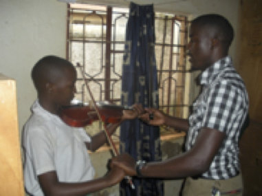 Sam teaching a student at St Mary Kevin School