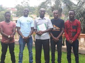 Teacher Godfrey with the Brass Students