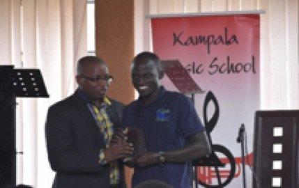 Ugen receiving his award