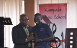 Ugen receiving his award