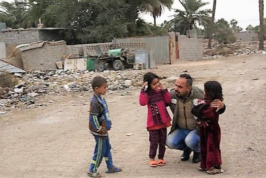 Street lawyer talks to kids in displaced area