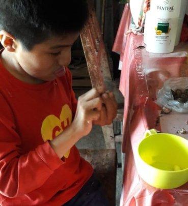 Jose peeling garlic