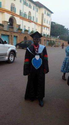 Joseph on graduation gown